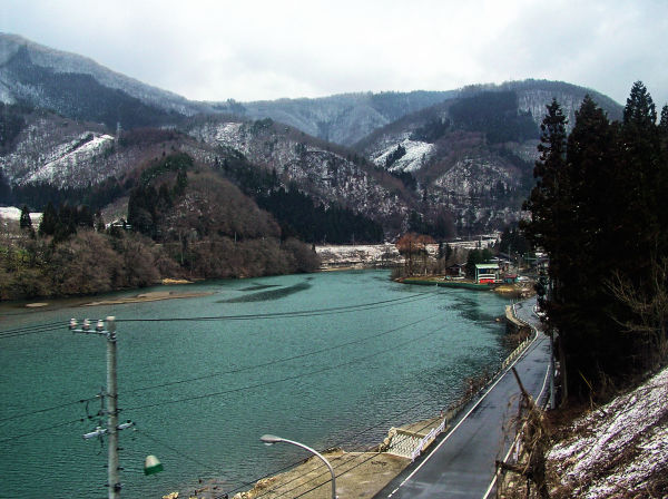 Gifu railway train snow Japan hill river