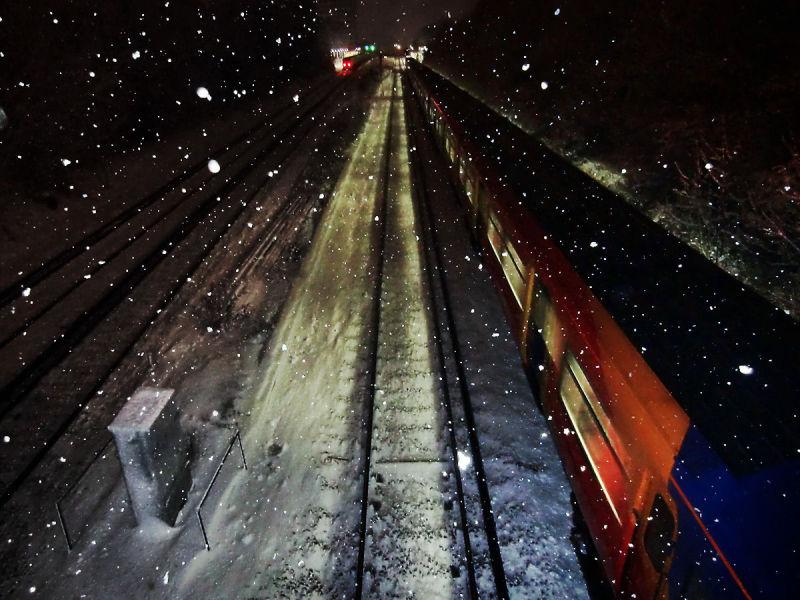 snow England New-Malden train bridge railway