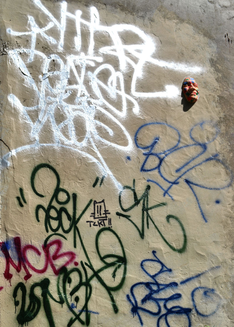 paris france montmartre graffiti sculpture wall