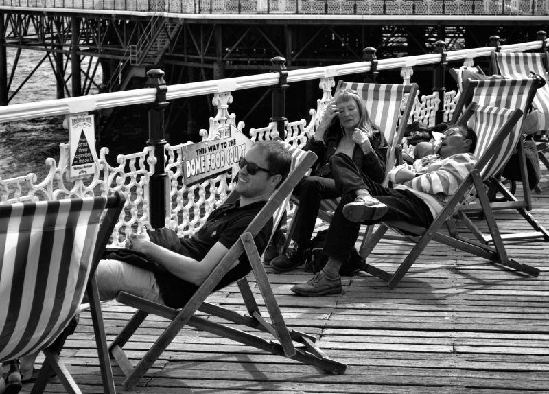 brighton england pier tourist deckchair