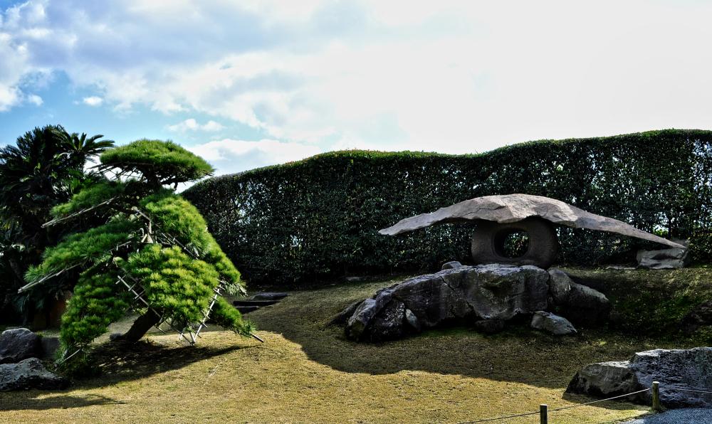 kagoshima kyushu japan sengan-en garden tree lante
