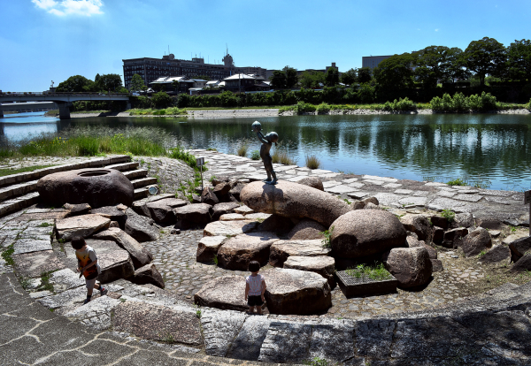 okayama japan momotaro statue river mia asahigawa