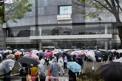 matsuyama shikoku japan crowd umbrella