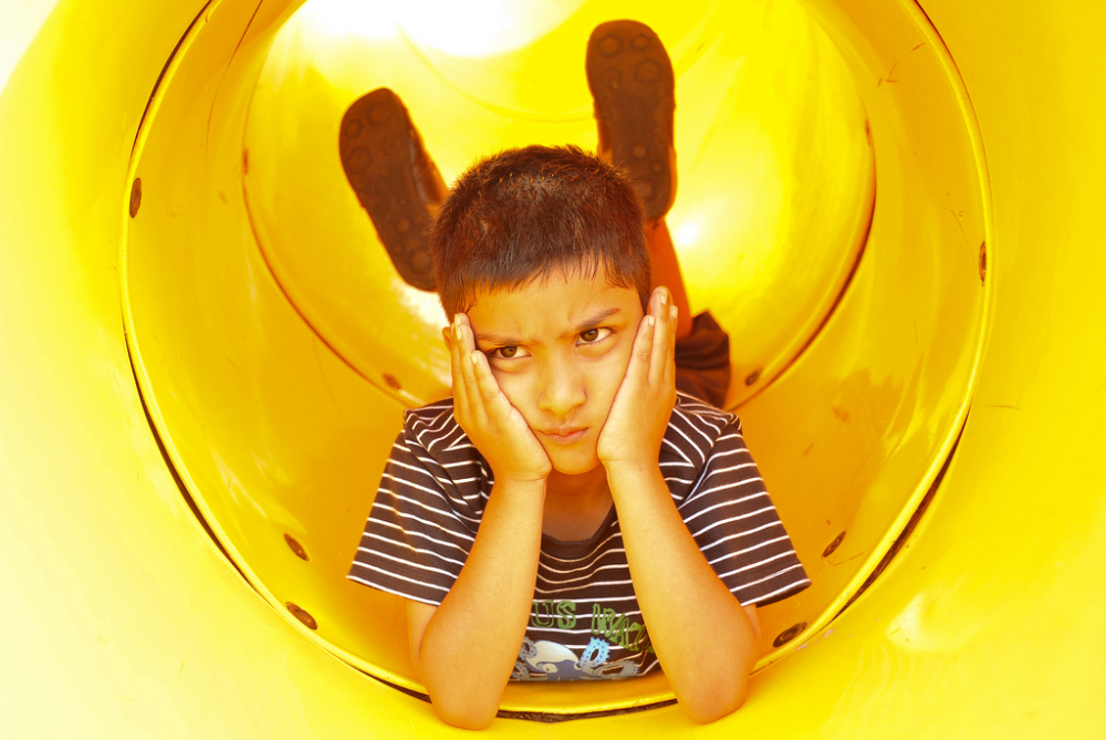 Boy in the yellow tube