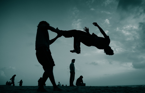 Acrobatic stunts at the beach