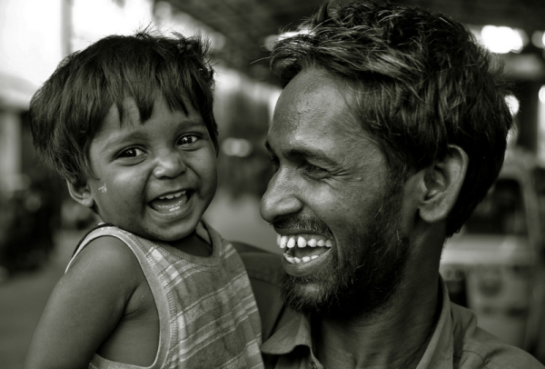 Beaming with joy, the little boy and his father