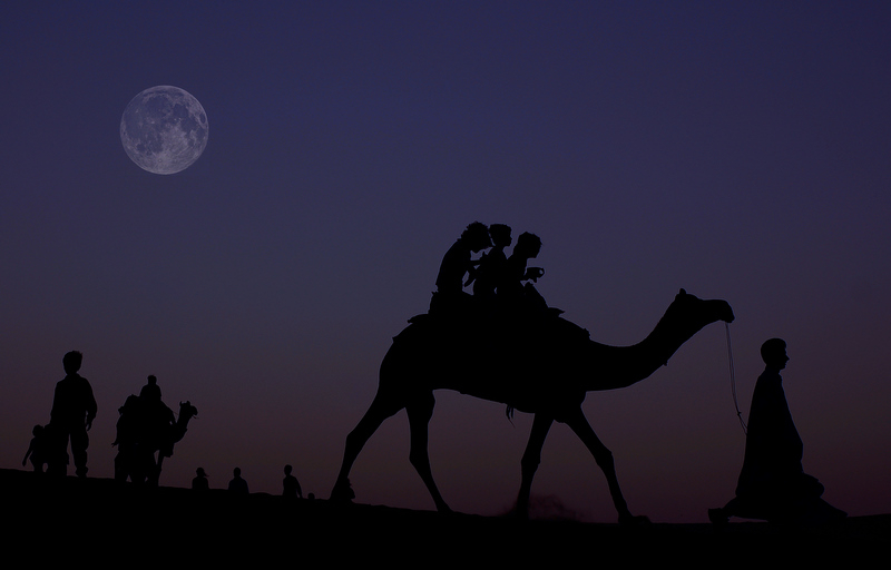 On top of a camel as the light fades away