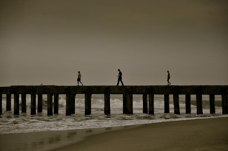 Three men at the pier