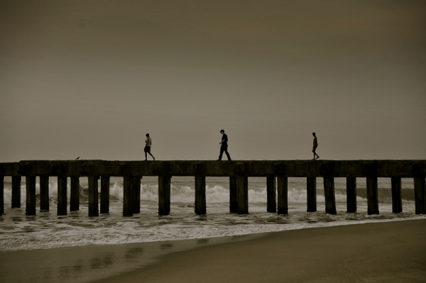 Three men at the pier