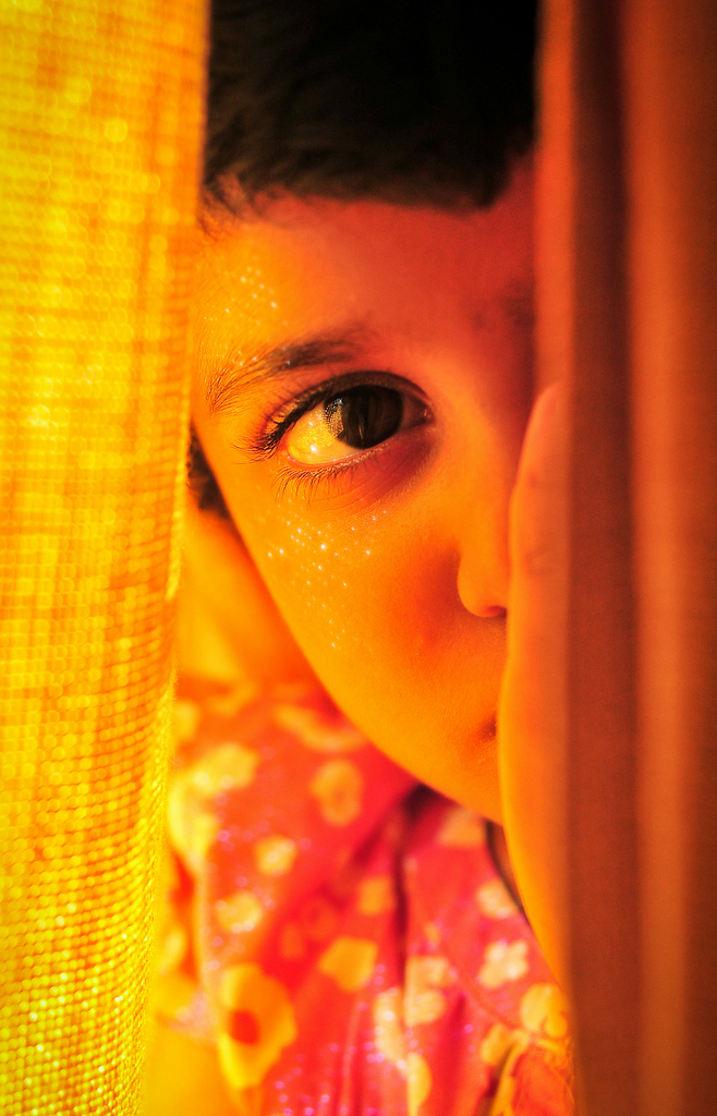 Hiding behind the yellow curtains