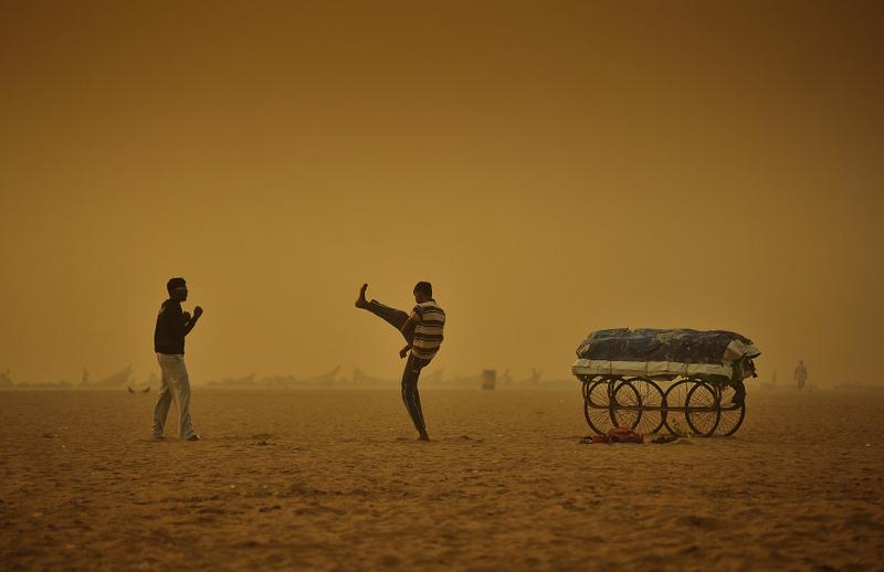 Stuntmen amidst the smog