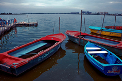 Boats rest on a gloomy day
