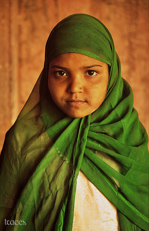 The girl with the green scarf