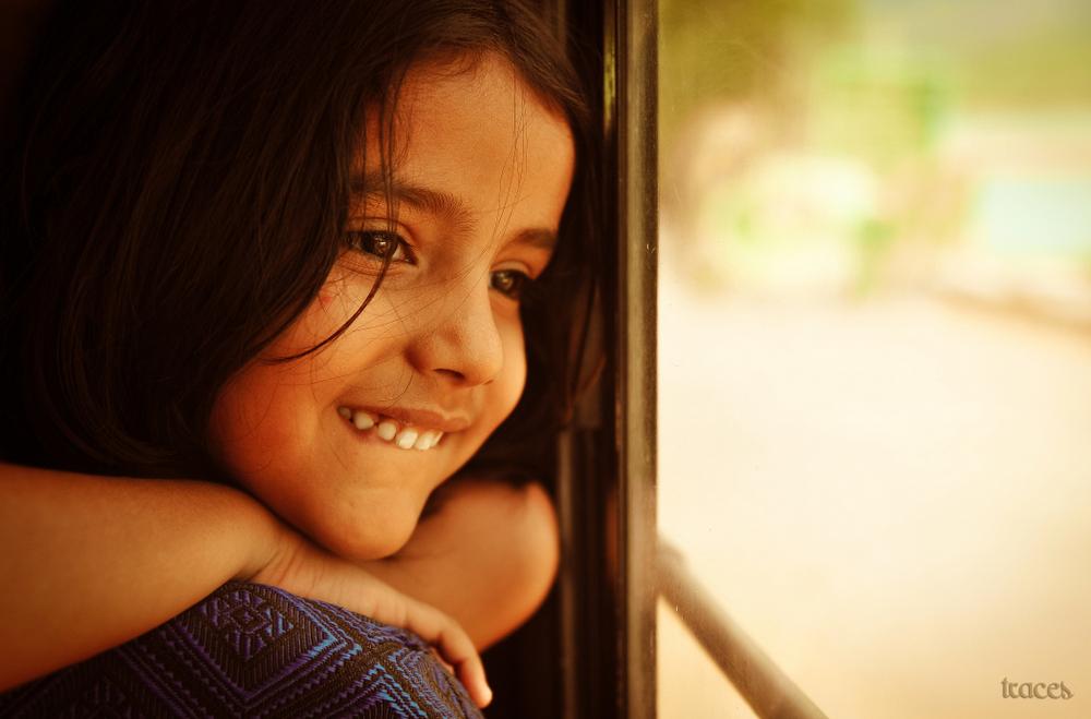 Along her window side!