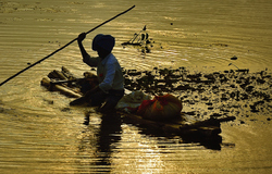 Sitting on his raft