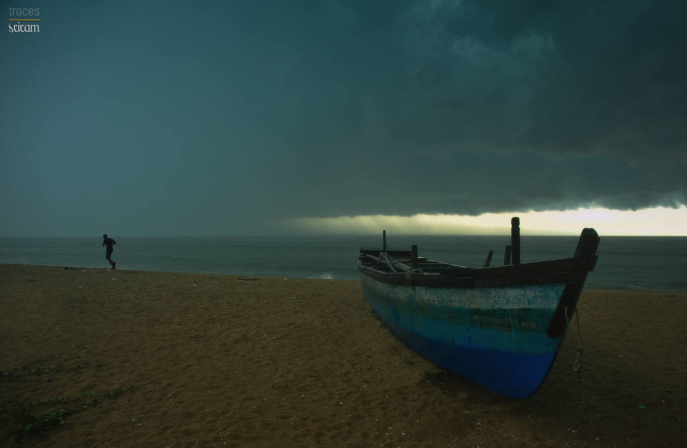 Dark clouds spread along the Madras coast