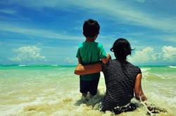 Mumma, boy and the beach