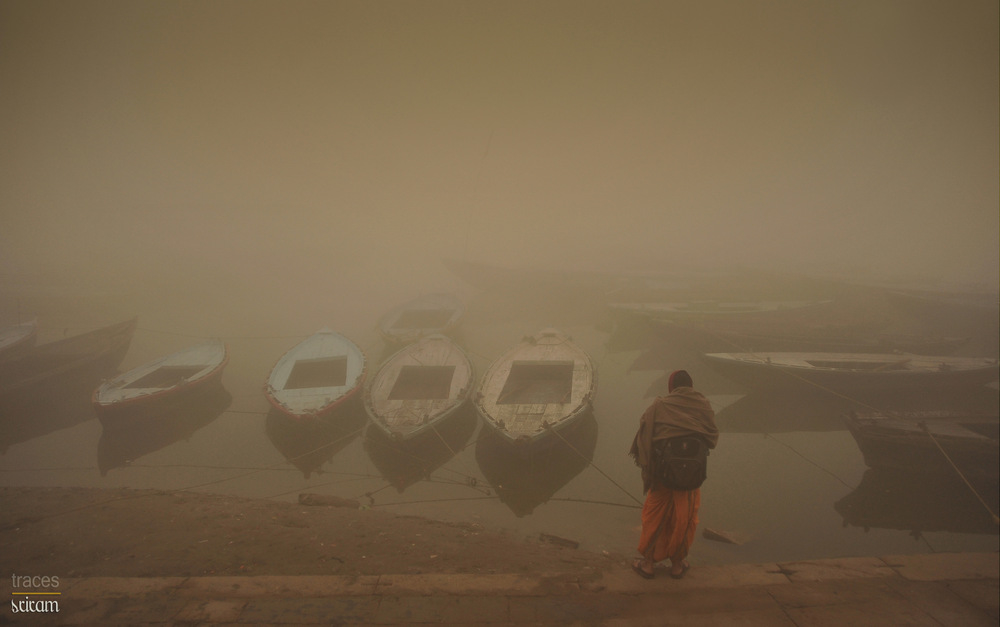 Waiting for his boat, on a chill winter morning!