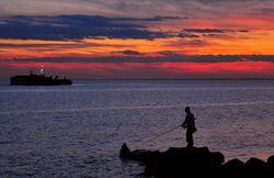 The lone fisherman at twilight