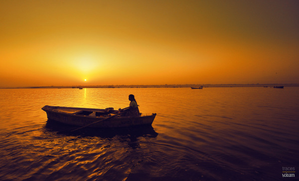 Selling flowers on the Ganges