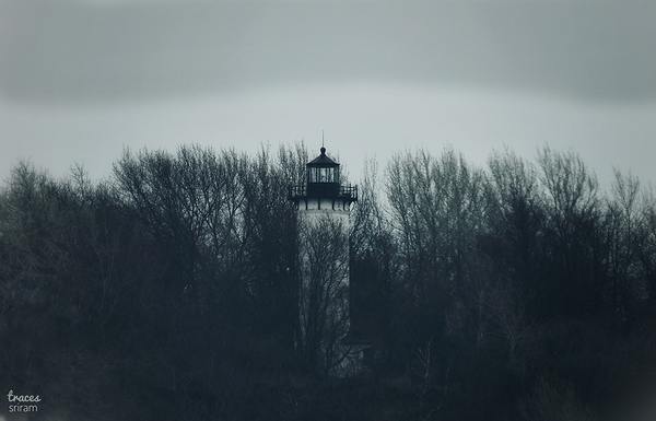 Lone light house on stormy noon