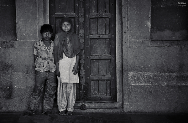 Siblings at the door