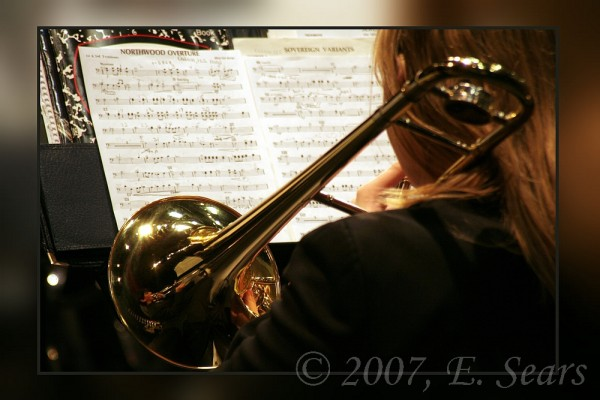 closeup photo of a trombone player