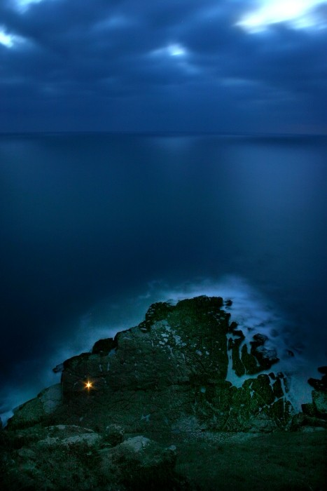 Fisherman alone, by night, in the coast of Sintra