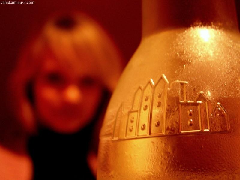 Girl behind bottle!