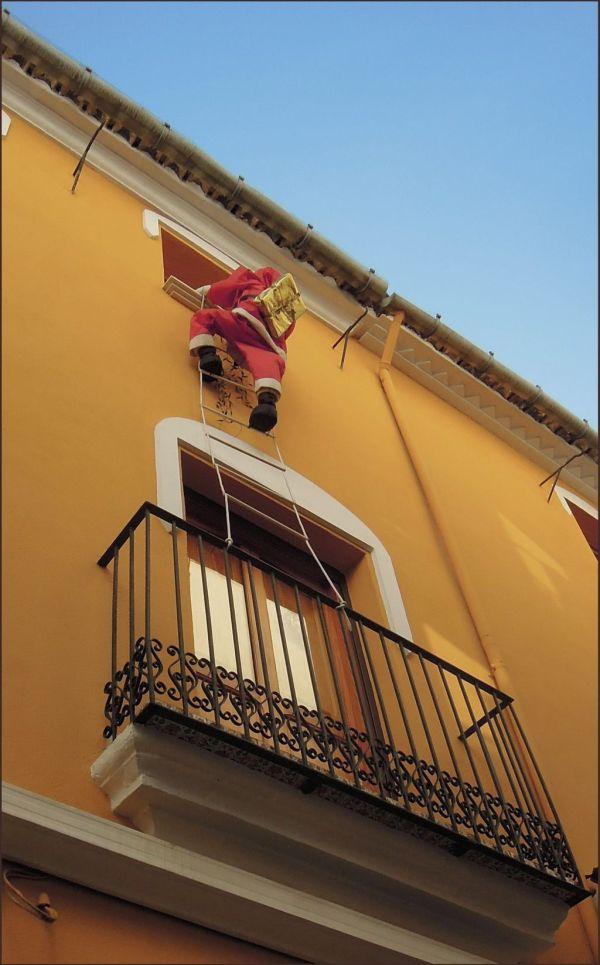 Ladder Climbing Santa Claus