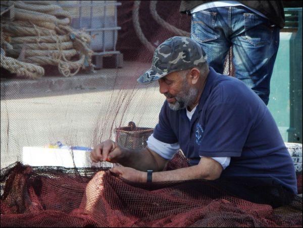 Fisherman in Jabia Mending Casting Nets
