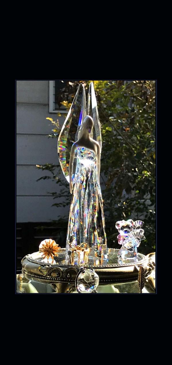 Sun Reflection in Swarovski's Angel Ornament.