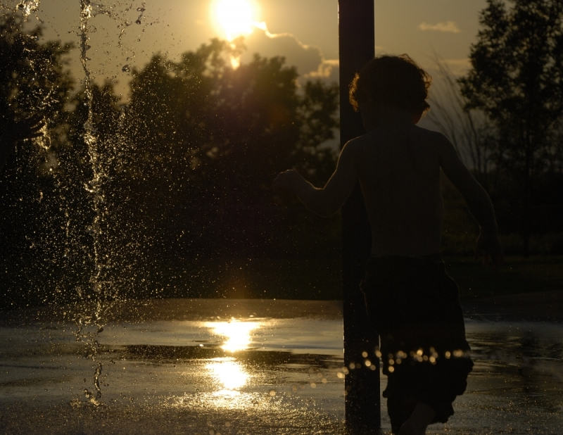 Water play under the sunset