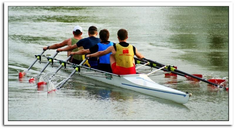 four men rowing