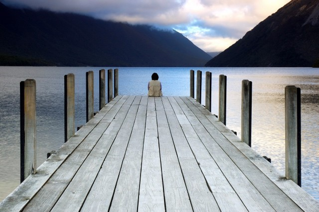 person sitting on the dock