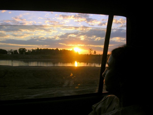 Watching the sunset from a running car