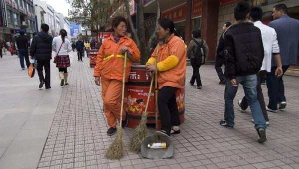 Two women wearing orange