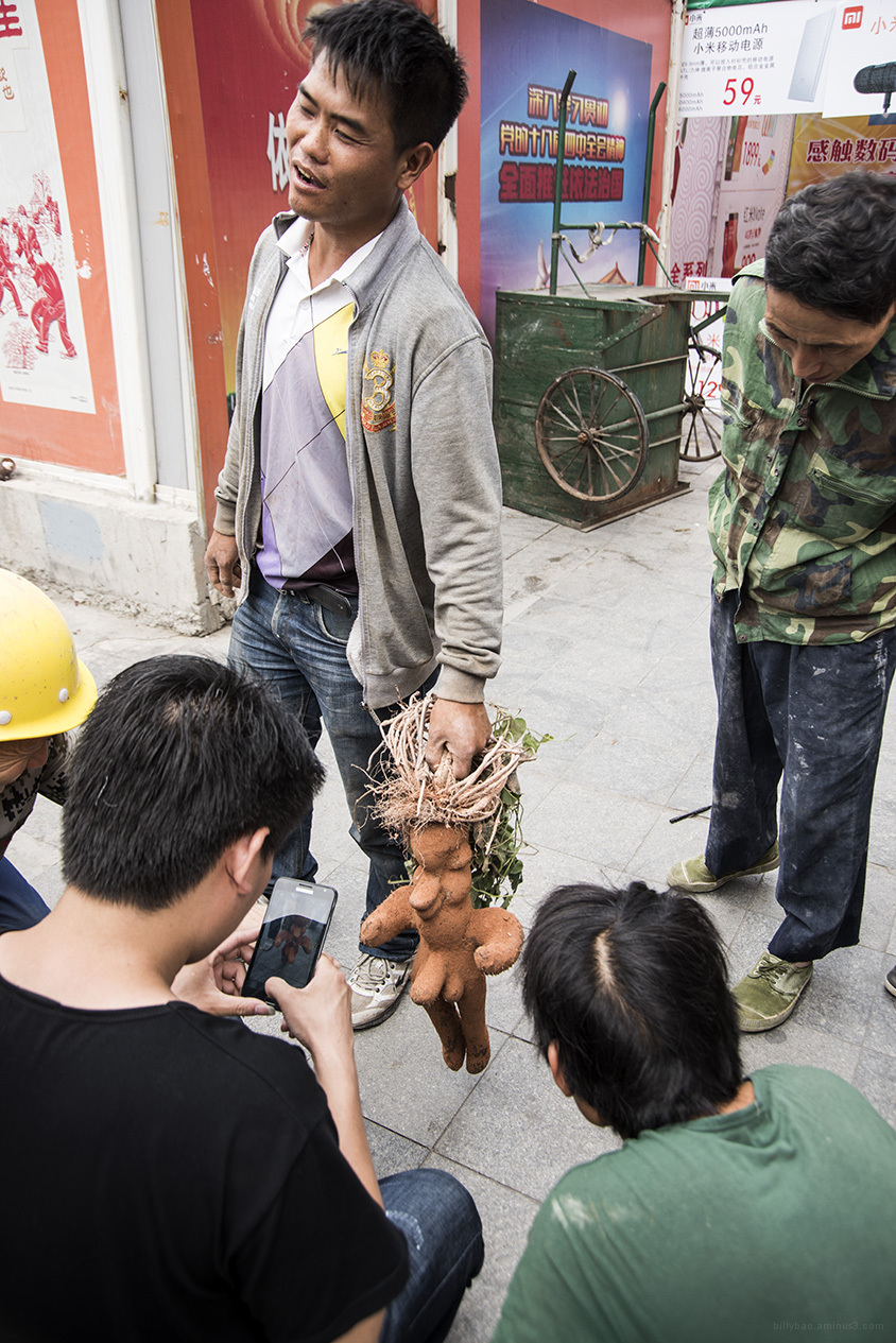 Man holding sweet potato, Shezhen China 2015