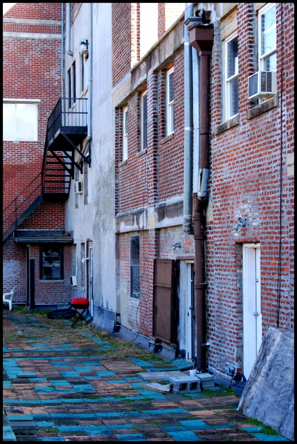 Side-porch of abandoned loft building.