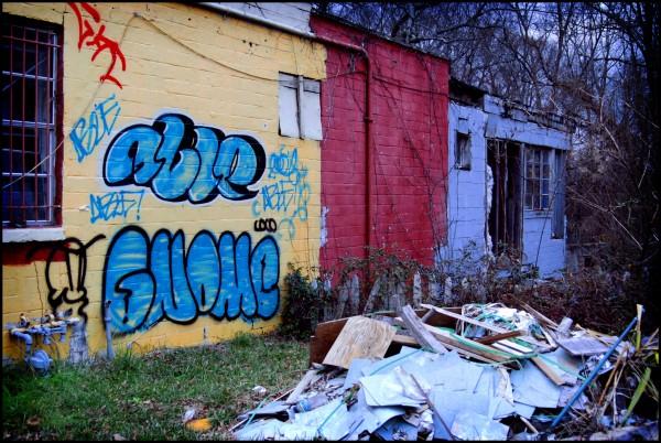 Abandoned building, debris and graffiti.