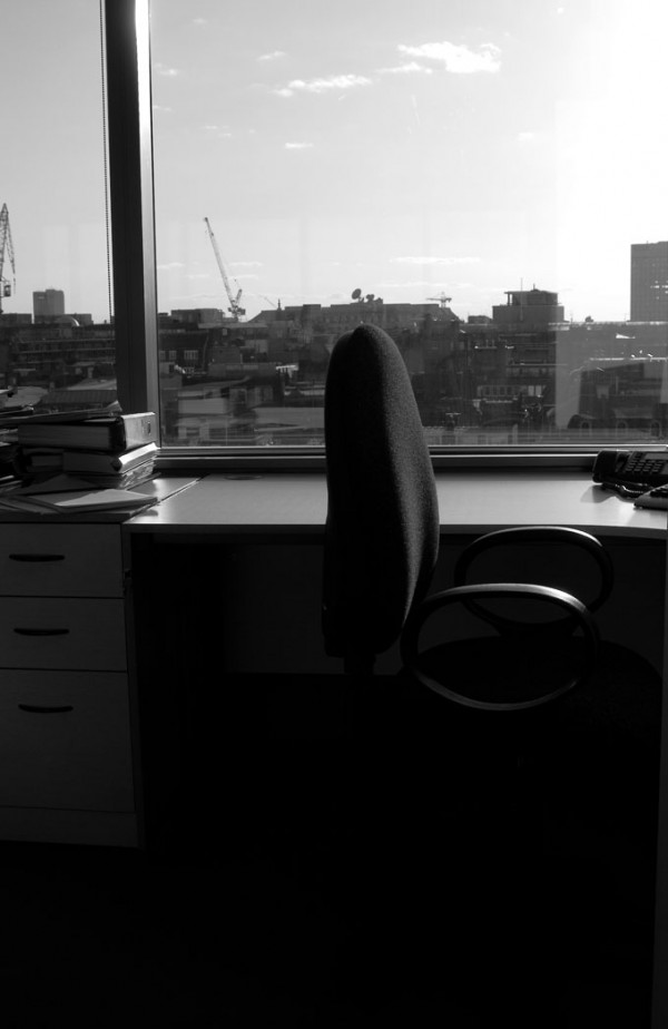 a chair in an office with a view over the west end
