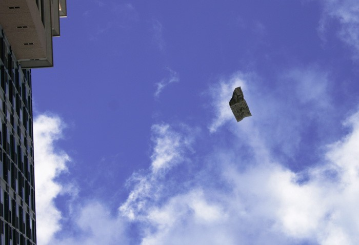 newspaper flying