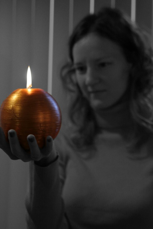 friend holding a candle
