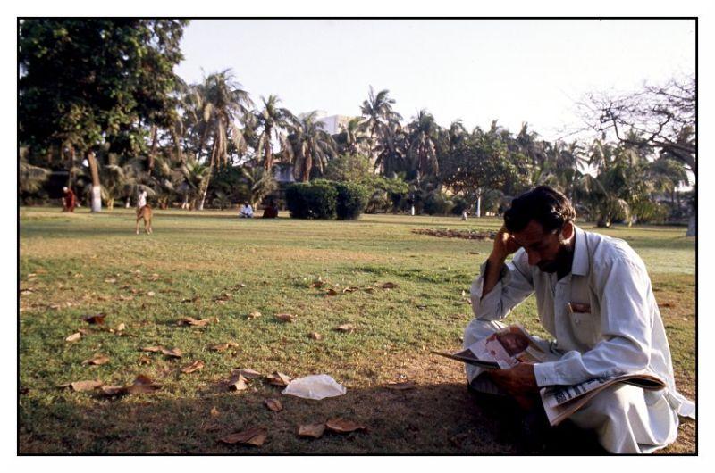 reading newspaper park karachi pakistan