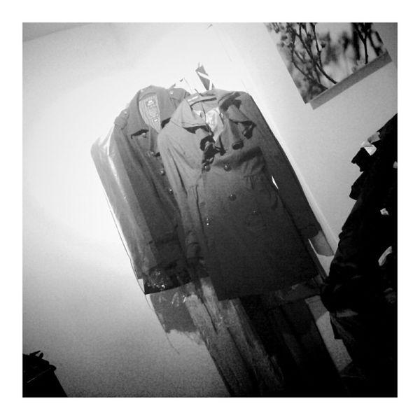 coats hanging in room
