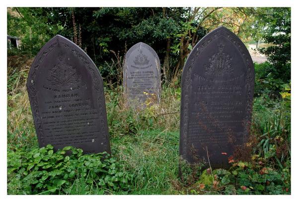 three gravestones one family plot