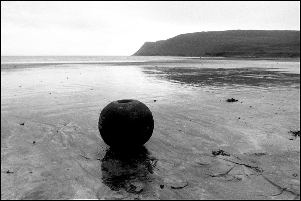 metal ball washed ashore scotland weight iron