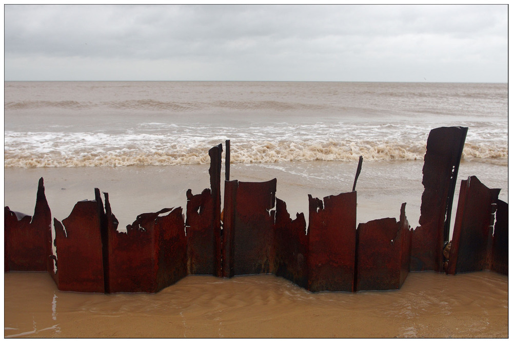 Happisburgh cliffs falling  broken beach apocalyps