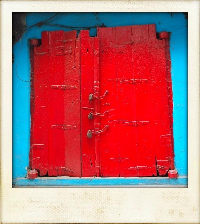Red door turquoise walls chandni chowk new delhi