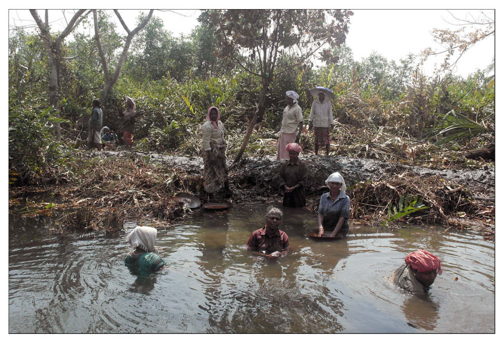 river silt mud clearance work people villagers